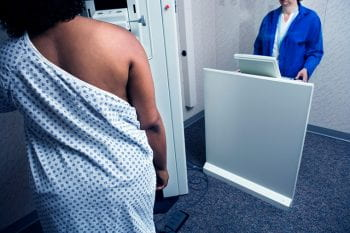 Image of African American woman receiving a mammogram