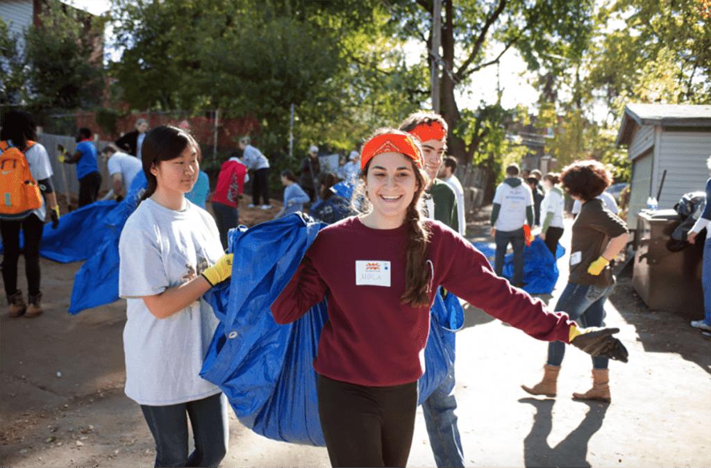 Washington University volunteers build a new KIPP playground
