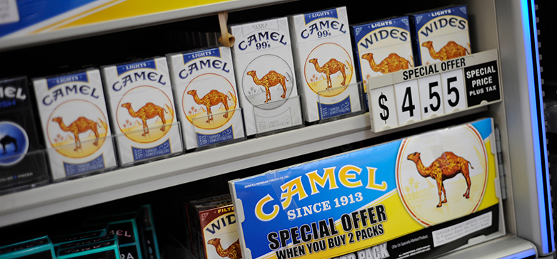 Retail store cigarette display showing special offer for Camel cigarettes