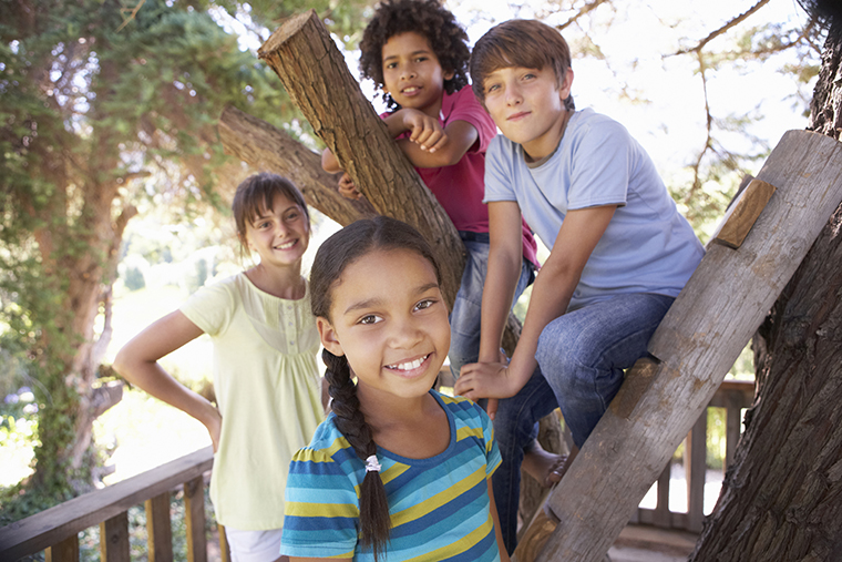 Group of children hanging out in treehouse