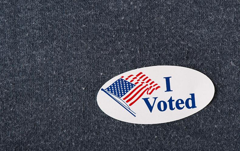 I voted sticker on a navy shirt