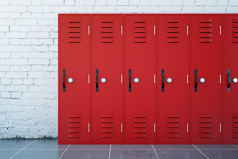 Line of red lockers in hallway