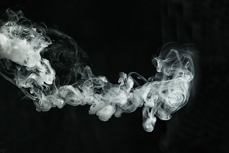 Line of smoke on dark background