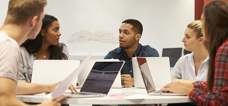 Group of college students collaborating on project