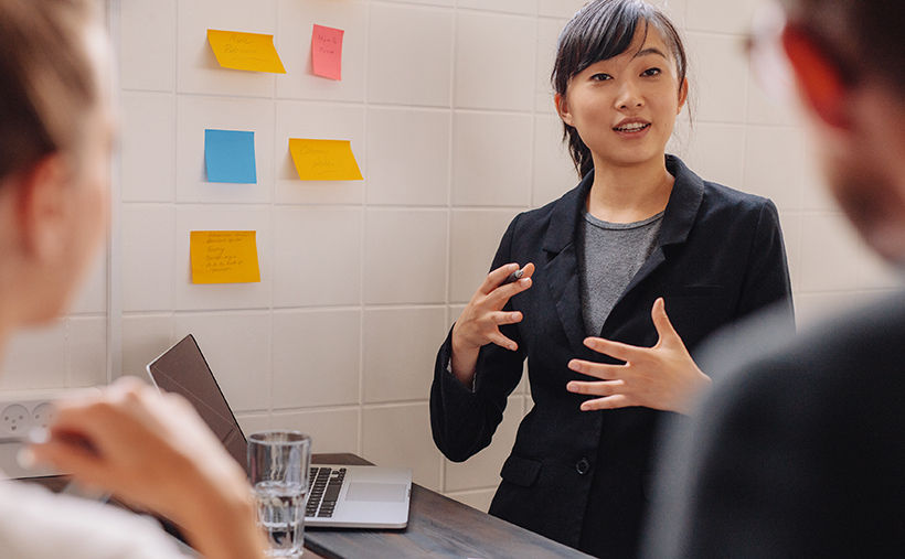 Woman executive explaining work plan to team
