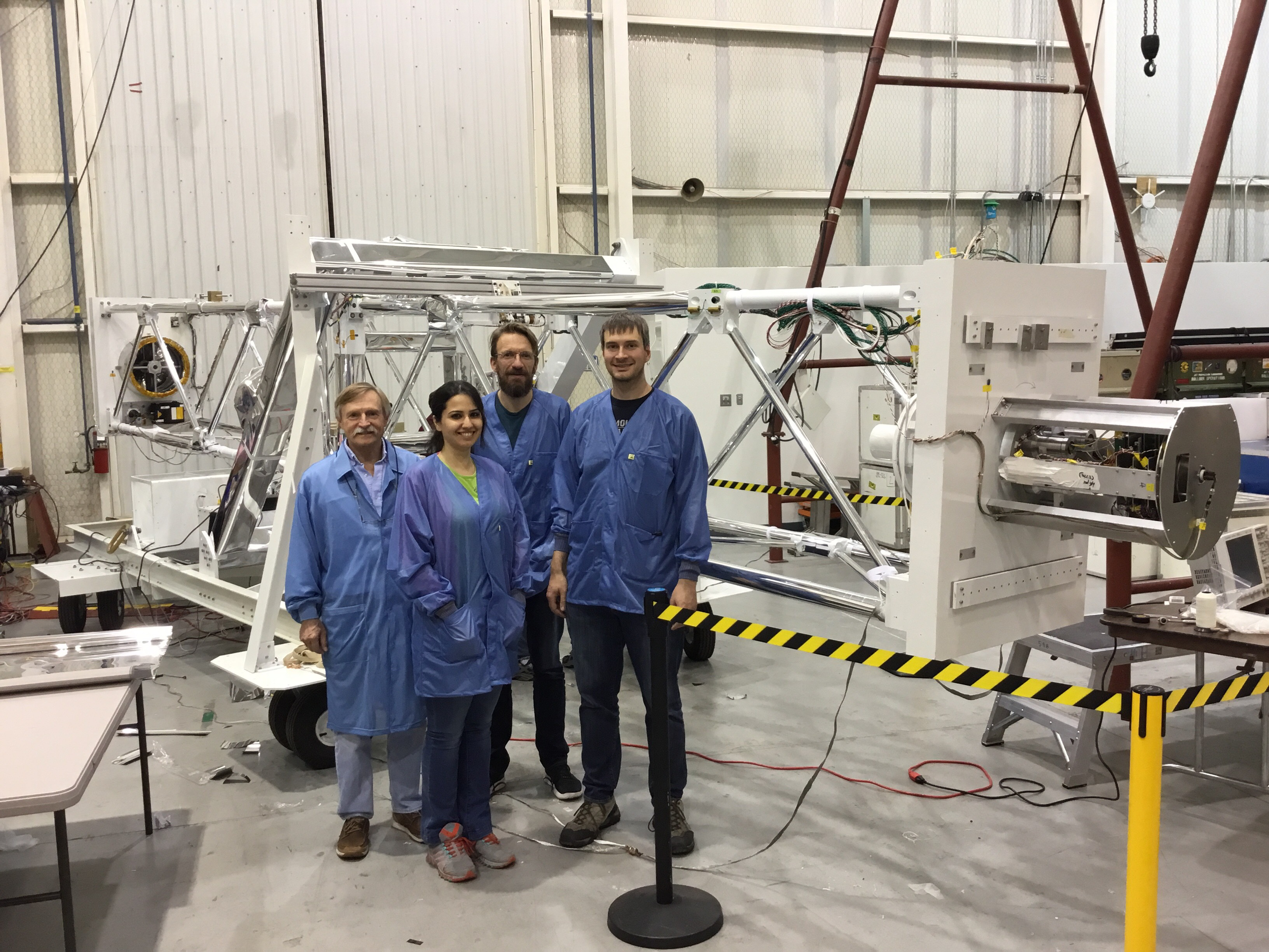 From left to right: Electrical engineer Pal Dowkontt, graduate student Banafsheh Beheshtipour, Professor Krawczynski, and Professor Kislat in front of the X-ray telescope which will be launched in September 2016 to spy on black holes and neutron stars in our Milky Way galaxy.