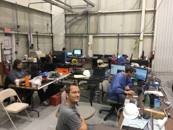 The night crew waiting for the rain and thunderstorms to pass. Dr. Matthias Beilicke can be seen in the front of the photo.