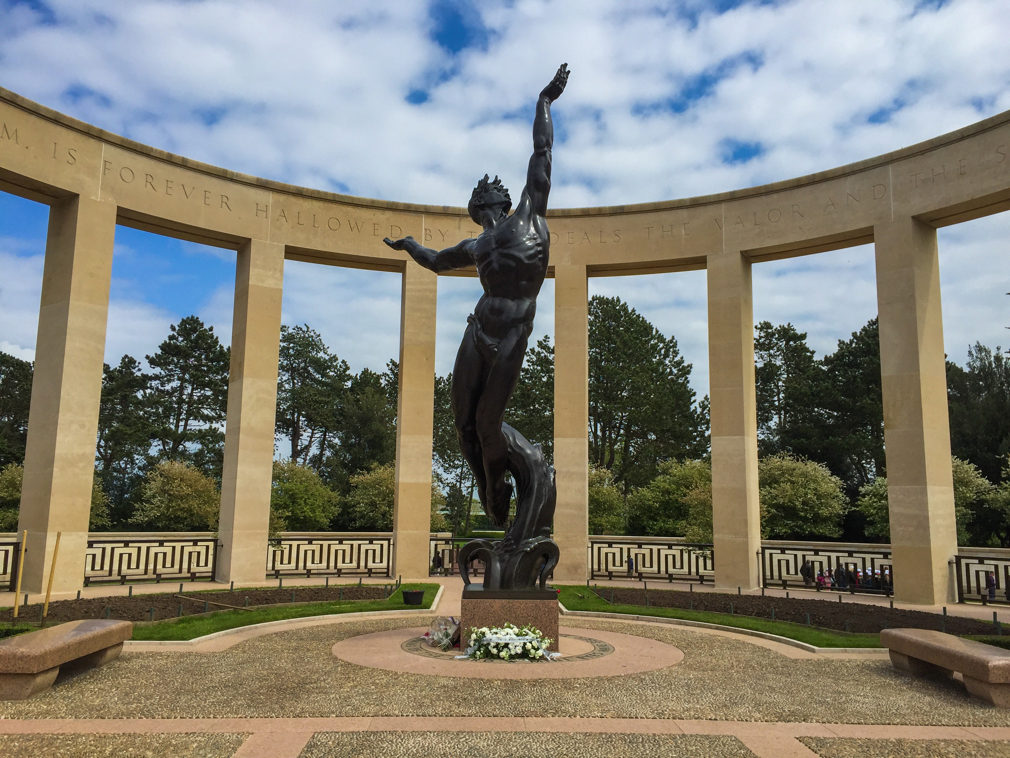 """""""Spirit of American Youth Rising from the Waves"""" bronze statue at the American Military Cemetery, Normandy."""