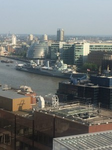 Historical landmarks, such as the HMS Belfast, were often seen surrounded by modern buildings.