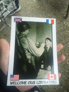 """Post card featuring the """"Welcome our Liberators"""" phrase."""