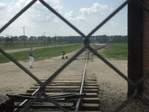 This is a view from the front of Birkenau. Through the fence, the train tracks can be seen going straight to the back of the camp.
