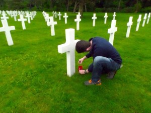 I placed an Ohio State University flag at one of the twelve Ohio State students. alumni, and staff graves at the Normandy American Cemetery and Memorial.