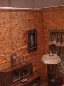 The dollhouses produced during the Nazi Era had framed pictures of Hitler hanging in the living rooms.
