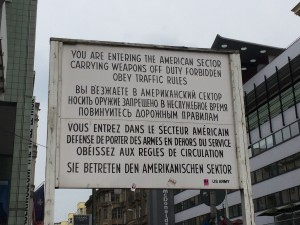 Sign at Checkpoint Charlie, where people could cross from one side of the Berlin Wall to the other.