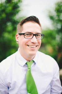 Headshot of Gabe Tippery, MFA outdoors in a tie.