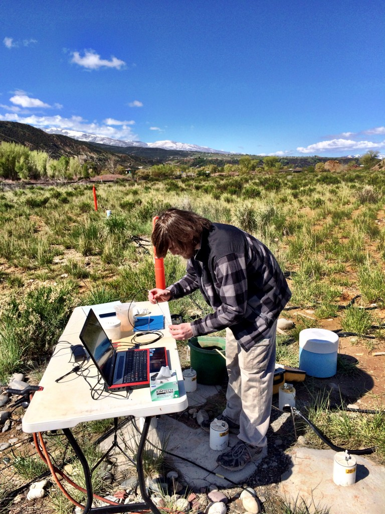 Bob measuring dissolved oxygen concentrations in groundwater at the site