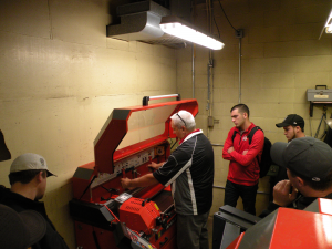 Students gaining insight on reel grinding from Doug Veine of Bernhard