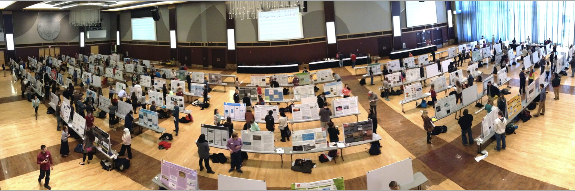student poster symposium with students presenting posters in Ohio Union
