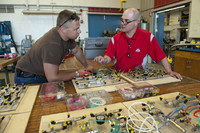 Two men working together and discussing a building and design project