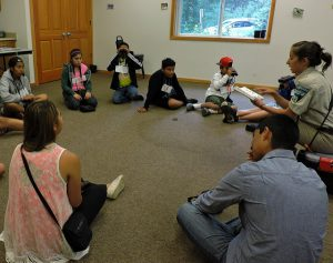 School counselor sitting in circle with students