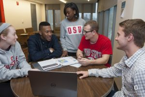 Diverse group of Ohio State students working together on an assignment