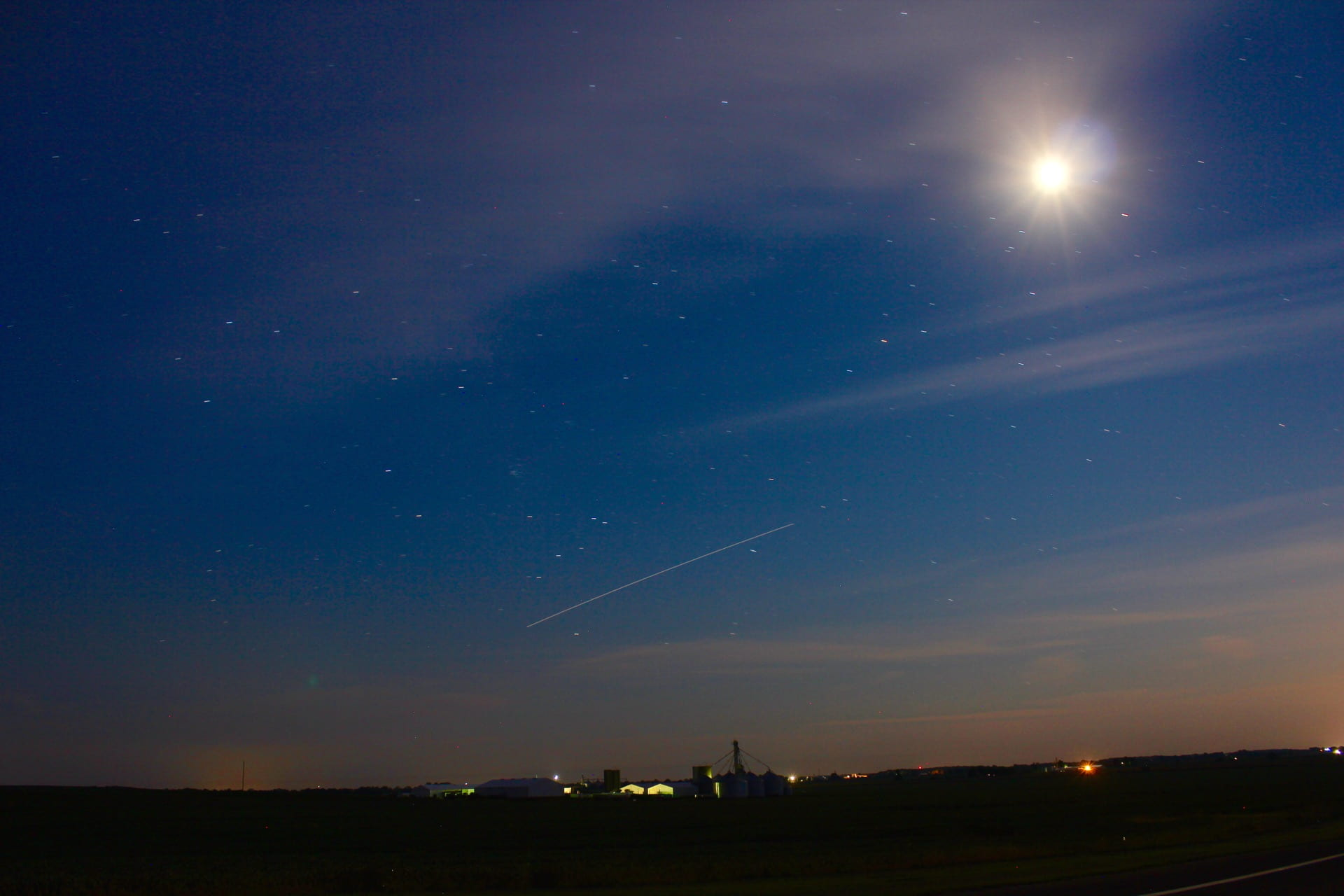 International Space Station is shown over a farm. The International Space Station (ISS) is shown as a streak in the sky in the picture above. Join Dr. Tom Blaine to learn how to identify ISS and constellations in the night sky.