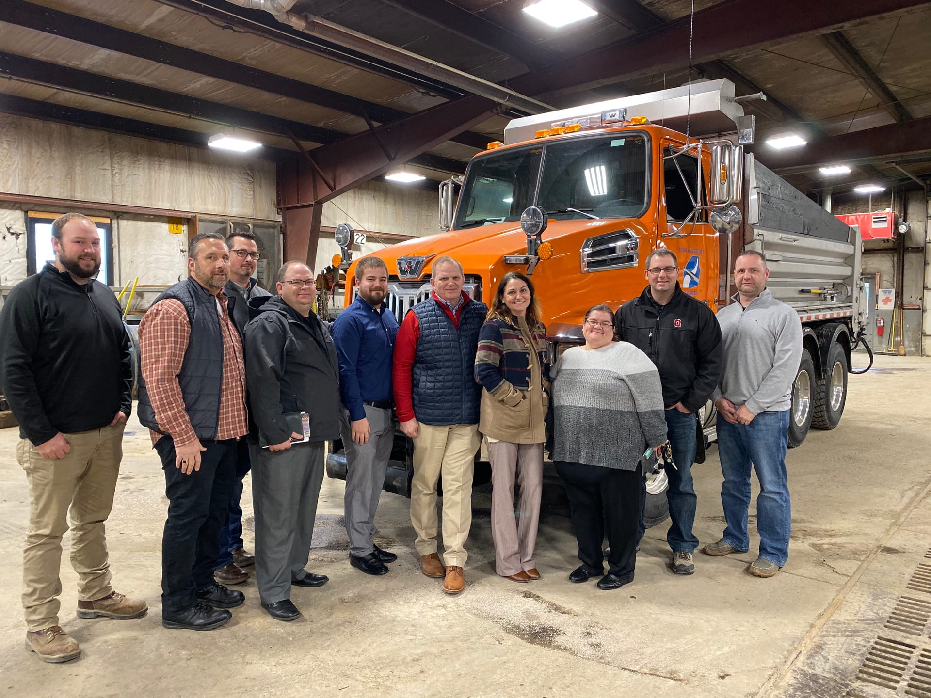 Left to right: Christian Dunlap, Bill Davis, Mel McKenzie, Jim Tomko, Jacob Alexander, Scott Lewis, Courtney Gallimore, Amanda Hall, Blaine Williams, and Highland County Engineer Chris Fauber in the shop at the Engineer's Office.