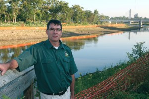John Navarro poses along a restored stretch of the Olentangy River in Columbus. Removing a nearby obsolete dam helped key the restoration.