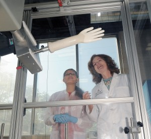 Graduate student Cindy Barrera Martínez (left) and researcher Katrina Cornish make latex gloves for testing at OARDC's alternative rubber pilot plant in Wooster.