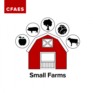 Photo of a red barn with an apple, pig, tree, vegetable and cow surrounding barn
