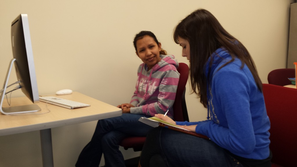 Noraisa Jones, left, a Respiratory Therapy student at Ohio State Mansfield, receives information about the Writing Center from writing consultant Katherine Nixon. Individual attention is one reason students are drawn to regional campuses.