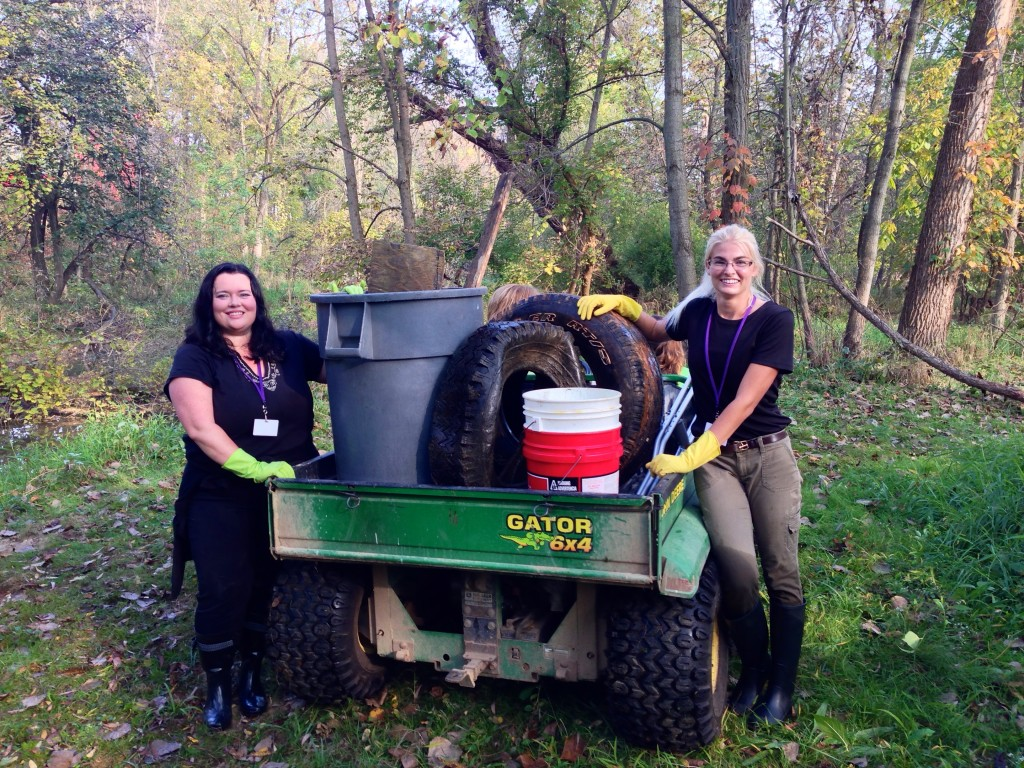 Ohio State Mansfield Education students Mellissa Johnson, left, and Paige Poffenbaugh show some of the debris that students at Eastern Elementary School in Lexington found in a Clearfork tributary. The duo created the service learning project for the students.