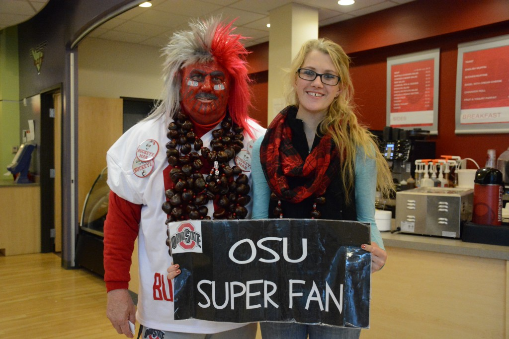 Buckeyeman Larry Lokai and granddaughter Catherine Williams visit the Cyber Café.