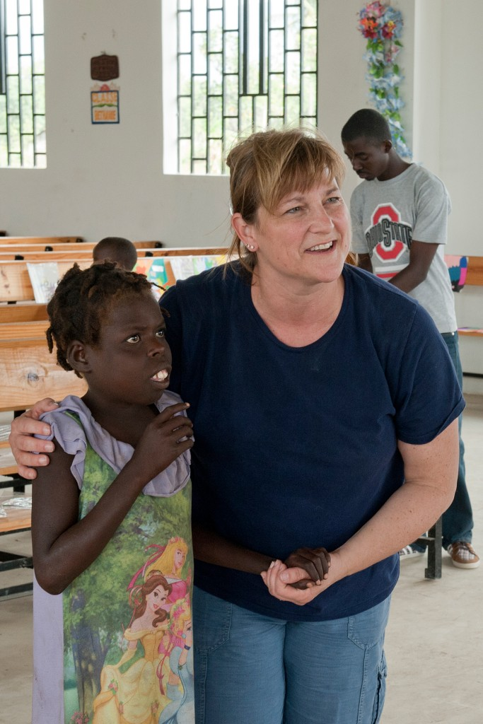 Dr. Terri Bucci, Ohio State Mansfield Education professor, works in a classroom during one of her trips to Haiti. She received the Distinguished International Engagement Award from Ohio State.