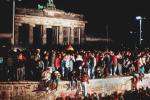 Cheering people stand on the Berlin Wall at Brandenburg Gate on Nov. 9, 1989.