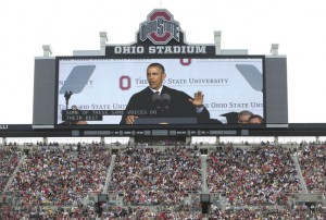 President Barack Obama is seen on a huge video screen as he speaks during the Ohio State University spring commencement in the Ohio Stadium, Sunday, May 5, 2013, in Columbus, Ohio. President Obama is the third sitting president to give the commencement speech at Ohio State University. (AP Photo/Carolyn Kaster)