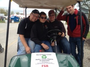 Craig (at the wheel) with three of his fraternity brothers. Two of the brothers are also agriscience education majors.