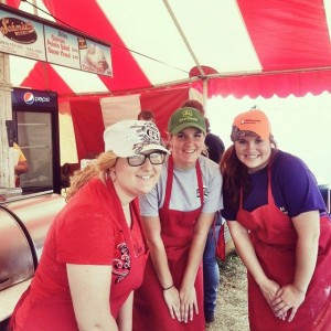 Miranda (orange hat) and two fellow Ag Ed Society members working at the Schmidt's Sausage Stand at Farm Science Review.