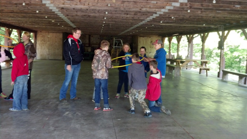 Blake assists youth with leadership activities.