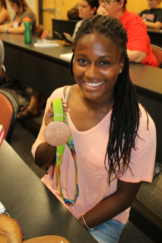 Nichelle Prince poses with her Bronze Medal from the 2016 Rio Olympics.