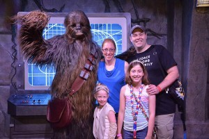 Tracy, wife Laura, and daughters Isabel and Violet at Disneyworld meeting Chewbaca from Star Wars.