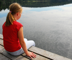 child on dock with water for GB