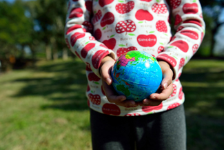 Photo of child holding globe 2