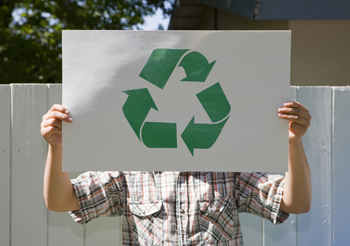 Image of person holding recycling sign 3