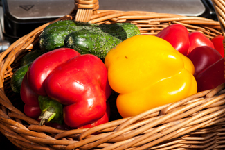 peppers with cucumbers in a wicker basket