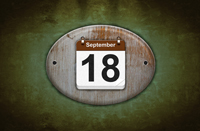 Old wooden calendar with September 18.