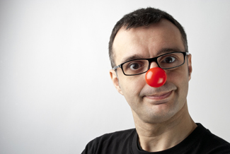 Man wearing a clown nose