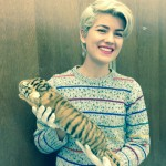 Chelsea holds a baby tiger skin.