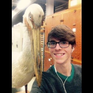 Grant next to an American White Pelican