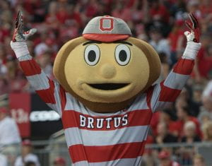 Brutus Buckeye with his hands in the air